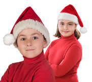 Two children with Christmas cap Royalty Free Stock Image