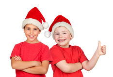 Two children with Christmas hat Royalty Free Stock Image