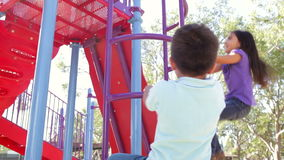 Two Children On Climbing Frame In Park stock footage