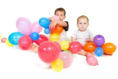 Two children with colorful balloons Royalty Free Stock Photos