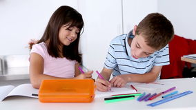 Two children colouring together stock video footage