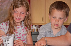 Two Children Cooking Stock Photos