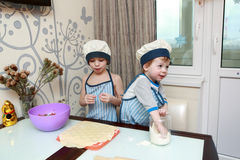 Two Children Cooking dumplings Royalty Free Stock Images
