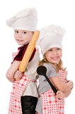 Two children cooks Stock Images