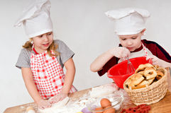 Two children cooks Stock Photo