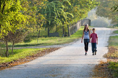Two children on country road Stock Images