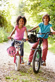 Two Children On Cycle Ride In Countryside Stock Photo