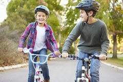 Two Children On Cycle Ride In Countryside Stock Images