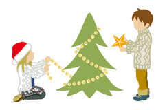 Two Children Decorating Christmas tree Royalty Free Stock Images