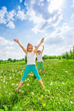 Two children doing gymnastics Royalty Free Stock Photos