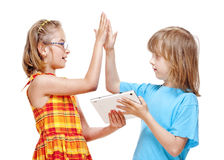 Two Children Doing High Five Gesture Stock Photo