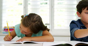Two children doing homework together. At home stock video