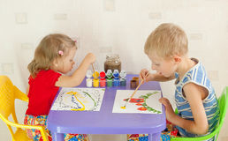 Two children draw Stock Image