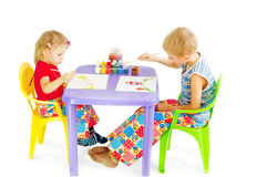 Two children draw paints Royalty Free Stock Photo