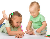 Two children are drawing Stock Photo