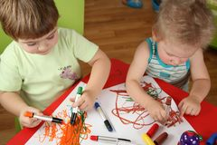Two children drawing Royalty Free Stock Images