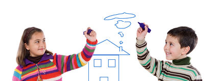 Two Children Drawing A House Royalty Free Stock Photography