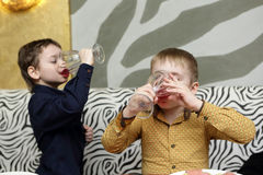 Two children drinking juice Stock Photo