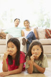 Two Children Eating Cookies At Home royalty free stock photo