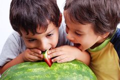 Two children eating watermelon Royalty Free Stock Photos