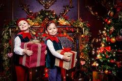 Two children elves Stock Images