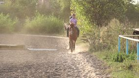 Two children are engaged in riding in countryside. stock video footage
