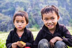 Two children of ethnic Hmong in the markets in Ha Giang, Vietnam. Ha Giang is home to mostly Hmong live Stock Photos