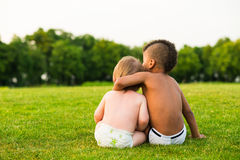 Two children on the evening glade. Stock Photography