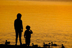 Two Children feeding the Duck Royalty Free Stock Photos