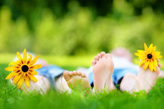 Two children feet on grass outdoors in summer park Royalty Free Stock Photos