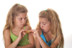 Two children fighting over cookie. Photo of two children fighting over cookie Royalty Free Stock Images