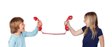 Two children fighting over phone Royalty Free Stock Image