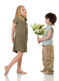 Two children with flowers. Two (girl and little boy) children with  flowers Royalty Free Stock Photos