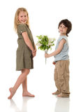 Two children with flowers. Two (girl and little boy) children with  flowers Stock Images