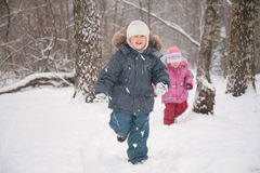 Two children in forest in winter Stock Image