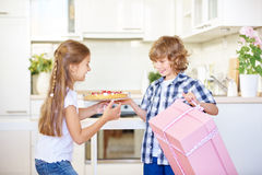 Two children with gift and cake as surprise Royalty Free Stock Image