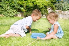 Two children on grass Royalty Free Stock Photos