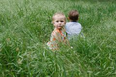 Two children in grass Royalty Free Stock Image