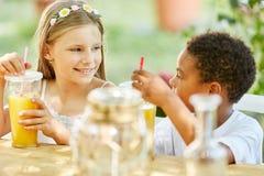 Two children having breakfast in kindergarten stock image