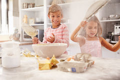 Two children having fun baking in the kitchen Royalty Free Stock Photo