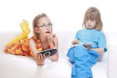 Two Children Having Fun with Digital Gadgets Stock Photos
