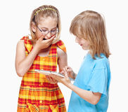 Two Children Having Fun with Digital Tablet Stock Photography