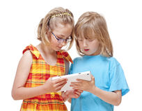 Two Children Having Fun with Digital Tablet Royalty Free Stock Image