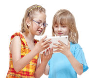 Two Children Having Fun with Digital Tablet Royalty Free Stock Photography