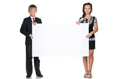 Two children hold a white board Stock Photos