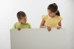 Two children holding a blank sign. You can add your own text Stock Image