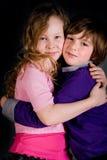 Two children hugging stock image