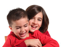 Two Children hugging isolated Stock Photos