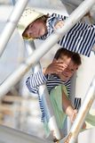 Two children - kids - having fun outdoors Stock Images