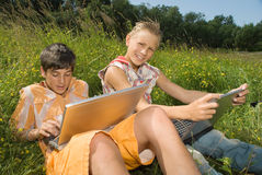 Two children with laptop stock images